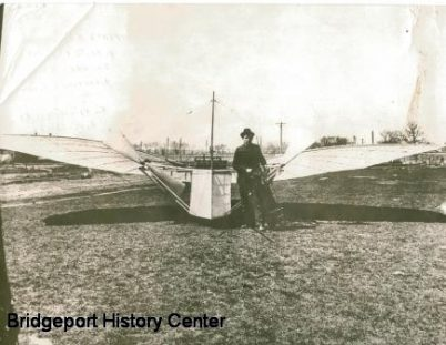 Gustave Whitehead near his plane.  No known photos exist of his plane in flight.